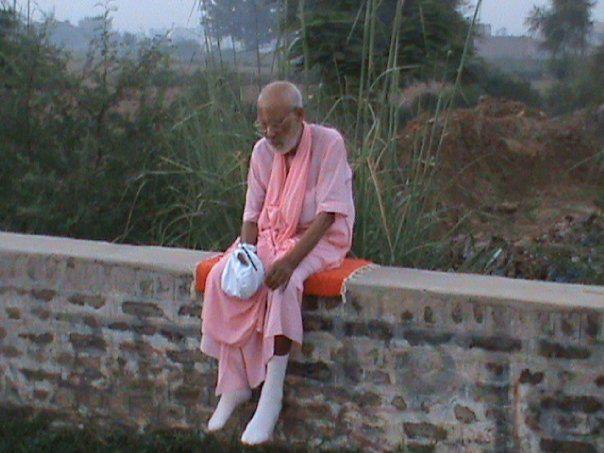 gurudeva sitting on wall